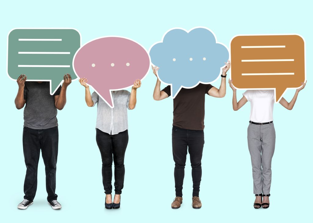 Diverse people showing speech bubble symbols